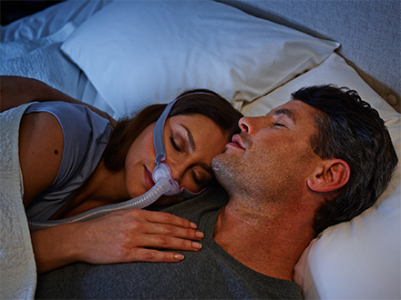 Patient-wearing-ResMed-AirFit-P10-nasal-pillows-minimalist-mask