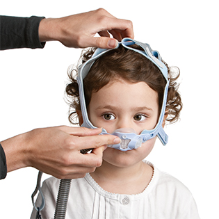 Pixi-paediatric-nasal-mask-worn-by-children-resmed