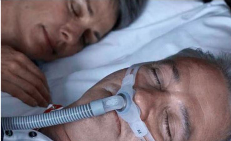 CPAP mask user at night with his wife ResMed UK blog