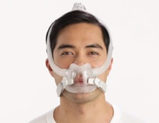 Man wearing ResMed full face CPAP mask